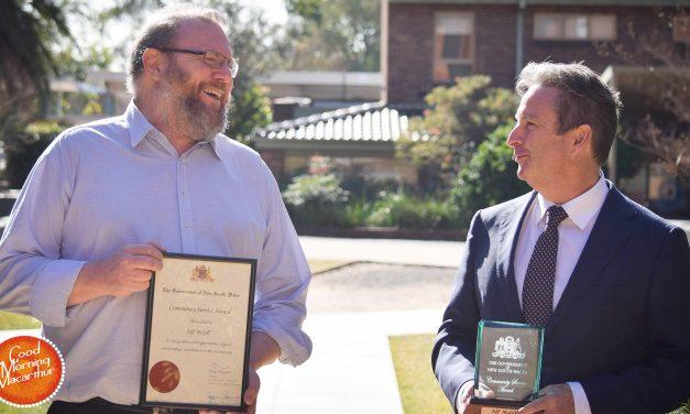 Greg Warren honours editor-historian Jeff McGill with a Community Service Award